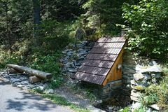 Medokys - well with mountain water adapted for tourists for refreshments. Beautiful Slovakia, background, clean, green, natural, nature, outdoor, spring royalty free stock photography