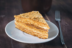 Medovik - layered honey cake on white plate Royalty Free Stock Photos