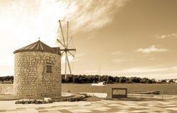 Medulin in Istria peninsula, Croatia. Wind mill in Medulin, Croatia , antique light saturation royalty free stock photos