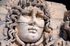 Medusa. An ancient stone carving. Stock Image