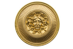 Medusa gold Shield. Medusa has the power to curse people into stone Stock Photo