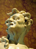 Medusa Gorgon closeup. Statue of Medusa - Gorgon against a textured background Stock Photography