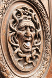Medusa Gorgon door panel, Paris France. Wooden carvings on the doors in Paris Royalty Free Stock Image