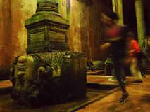 Medusa head in Basilica Cistern with person inmotion out of focus royalty free stock images