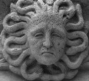 The medusa head. Shot in black and white, detail on an sculpture representing medusa placed on the facade of the church , set in Garraf, Sitges, Catalonia Stock Photo