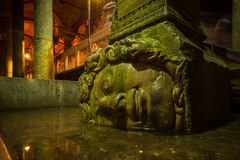 Medusa. A large Medusa head supports a column at the Basilica Cistern in Istanbul, Turkey royalty free stock photography