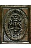 Medusa on Wooden Door In Paris. Sepia Tone Face  of Medusa on wooden door on build Stock Images