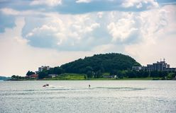 Medvedia mountain over the Zemplinska Sirava lake. Slovakia. Lovely place for vacation or weekend in summer. people water skiing on one of the largest Royalty Free Stock Photo