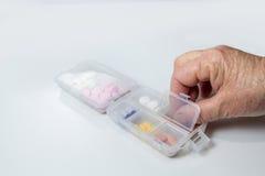 Medycyna w pigułki stary wyga i pudełku Obraz Stock