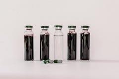 Medyczne buteleczki z ekstraktem Zdjęcia Stock