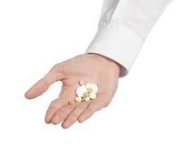 Medyczny temat: lekarki ręka trzyma białą pastylkę odizolowywająca dla zdrowie na białym tle Zdjęcie Stock