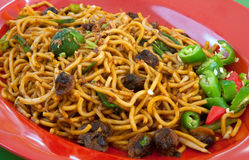 Mee Goreng Kerang. Malay style spicy fried noodles with onion bits Stock Images