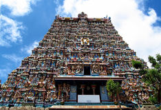 Meenakshi Amman Temple Tower. Madurai gopuram Meenakshi Amman Temple (Meenakshi Sundareswarar Temple) in India. Colored statues decorating the tall geatway Stock Image