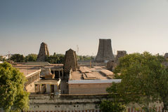 Meenakshi Temple. The temple of Meenakshi in Madurai, Tamil Nadu, showing 3 gopurams (towers) wrapped while they are being repainted Royalty Free Stock Images