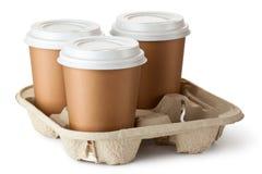 Meeneemkoffie drie in houder Stock Fotografie
