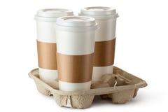 Meeneemkoffie drie in houder Royalty-vrije Stock Afbeeldingen