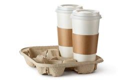 Meeneemkoffie twee in houder Stock Foto