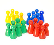 Meeple. Four groups of six different colored figures isolated on white background stock photography