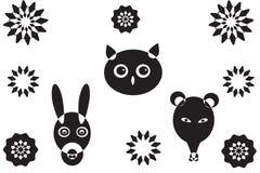 Meer dierlijke hoofden en bloem s Stock Foto