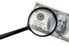 meer magnifier met dollars Stock Afbeelding