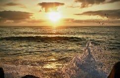 Meer am Sonnenuntergang Stockfoto