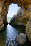 Meer u. Höhle stockbilder