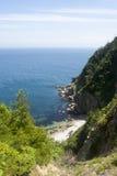 Meer und felsige Klippe Stockbilder