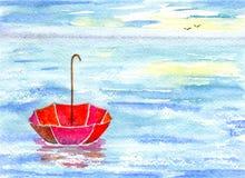 Meer und Regenschirm stockbild