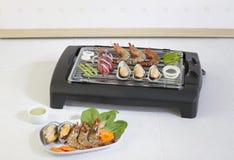 Meeresfrüchtegrilgrills auf dem Ofen lizenzfreie stockbilder