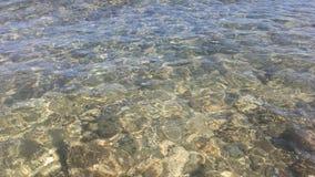 Meereswogen auf Sand in Kapaa auf Kauai-Insel, Hawaii Lizenzfreie Stockbilder