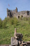 Meerkat - beneath English Castle Stock Photo