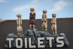 Meerkat toilet sign. Amusing as seen in zoo Royalty Free Stock Photo