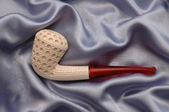 Meerschaum Pipe Series 1. A hand carved meerschaum pipe (A fine, compact, usually white claylike mineral of hydrous magnesium silicate, found in Eskisehir Stock Photography