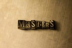 MEESTERS - close-up van grungy wijnoogst gezet woord op metaalachtergrond Royalty-vrije Stock Afbeelding
