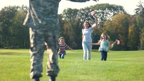 Meet of arrived military father concept. Rear view defocused soldier legs stock footage