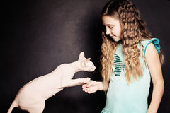 Meet the Cat. Cild Girl and Pet Royalty Free Stock Photos