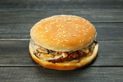 Meet and cheese burger at rustic wood Royalty Free Stock Photos