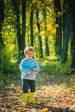 Meet fall season. Forest school is outdoor education delivery model in which students visit natural spaces. Boy in. Rubber boots walking in forest. Cute tourist stock photos