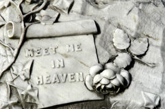 Meet me in heaven. Message left for family and friends on a very old tombstone Royalty Free Stock Photos