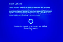 Meet Microsoft Windows Cortana. PARIS, FRANCE - JAN 7, 2016: Meet Cortana mouse keystroke- message on computer display during windows 10 upgrade. Cortana is Royalty Free Stock Photo