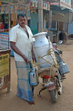 Meet the milkman. KALAKAD, TAMIL NADU, INDIA, circa 2009: An unidentified milkman makes his deliveries. India has the world's largest dairy industry Stock Photo