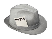 Meet the Press. Vintage trilby hat with press pass isolated on white Royalty Free Stock Images