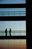 Meeting. People inside the building silhouette Royalty Free Stock Photography