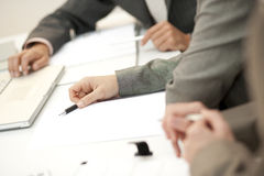 Meeting. Shallow depth of field, focus is on the pen Royalty Free Stock Images