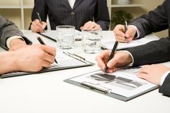 At meeting. Photo of business people hands working with documents at briefing royalty free stock photos