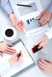 At meeting. Above view of business people hands working with documents at briefing royalty free stock photography