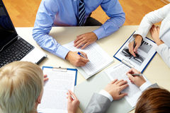 Meeting. Image of business people working with documents at meeting Stock Photos
