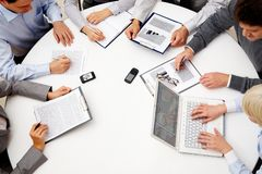 At meeting. Image of company of successful partners discussing business plan at meeting Stock Photos