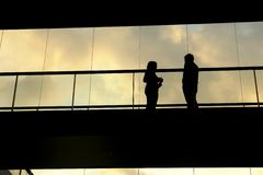 Meeting. A couple meetting in the modern building, silhouette Stock Photos