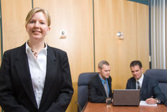 The meeting. 3 business people with woman in foreground stock photo